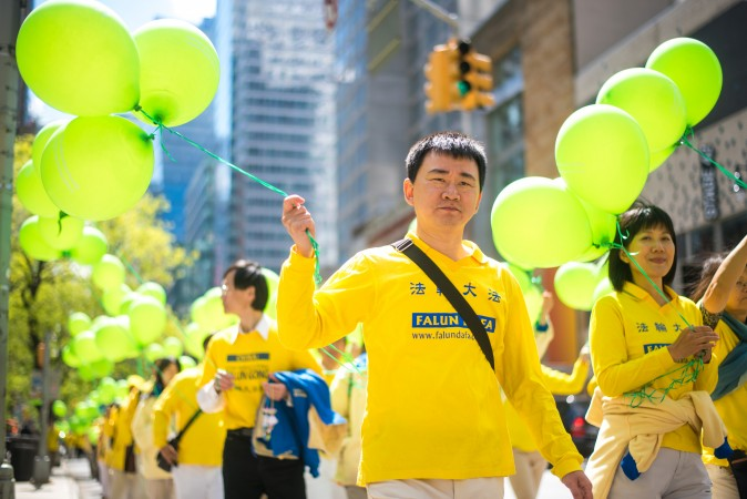 Thousands of Falun Gong practitioners march in a parade along 42nd Street in New York for World Falun Dafa Day on May 12, 2017. (Mihut Savu/The Epoch Times)