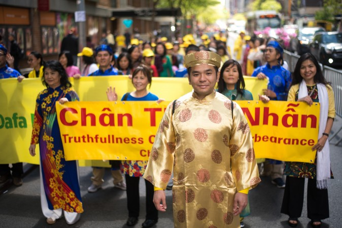 Falun Gong Practitioners from Vietnam march in the World Falun Dafa Day parade in New York on May 12, 2017. (Mihut Savu/The Epoch Times)