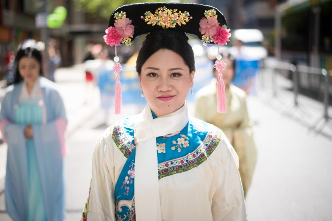 A Falun Gong practitioner wears traditional Chinese clothing during a parade along 42nd Street in New York for World Falun Dafa Day on May 12, 2017. (Mihut Savu/The Epoch Times)