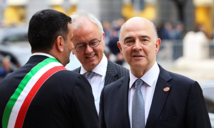 European Commissioner Pierre Moscovici (R) arrives at the Petruzzelli Theatre during a G7 for Financial ministers in the southern Italian city of Bari on Italy May 11, 2017. (REUTERS/Alessandro Bianchi)