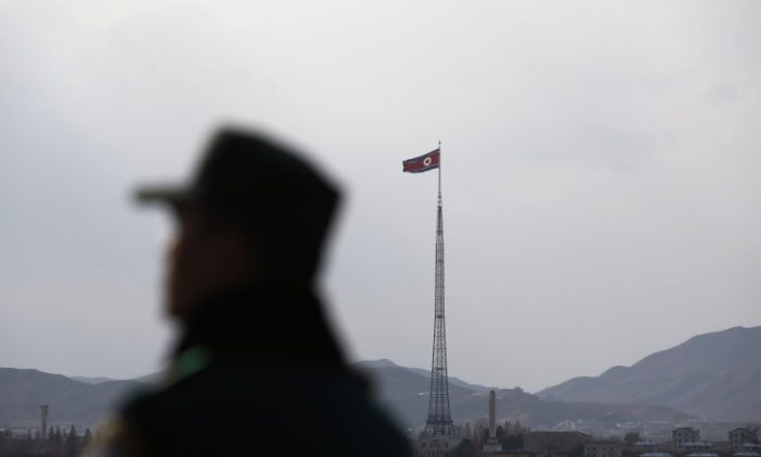 A North Korean flag flutters on top of a tower at the propaganda village of Gijungdong in North Korea, in this picture taken near the truce village of Panmunjom on Nov. 12, 2014. (REUTERS/Kim Hong-Ji)