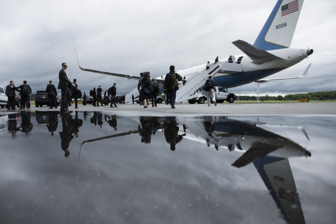 Traveling press and White House staff board Air Force One at Lynchburg Regional Airport in Lynchburg, Va., on May 13, 2017. (BRENDAN SMIALOWSKI/AFP/Getty Images)