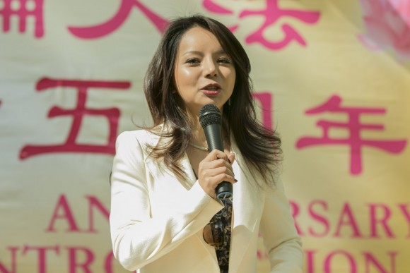 Anastasia Lin, the 2016 Miss World Canada, speaks at a World Falun Dafa Day rally on May 12, 2017. (Cao Jingzhe/The Epoch TImes)