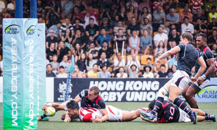 Japan winger Amanaki Lotoahea, stretches for the line for a try. Converted by Yamasawa, to take Japan to 13-0 in their Asia Rugby Championship match against Hong Kong in Hong Kong on May 13, 2017. (Dan Marchant)