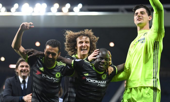 (L-R) Antonio Conte, Pedro, David Luiz, N'Golo Kante and Thibaut Courtois of Chelsea celebrate winning the league during the Premier League match between West Bromwich Albion and Chelsea at The Hawthorns on May 12, 2017 in West Bromwich, England. (Laurence Griffiths/Getty Images)
