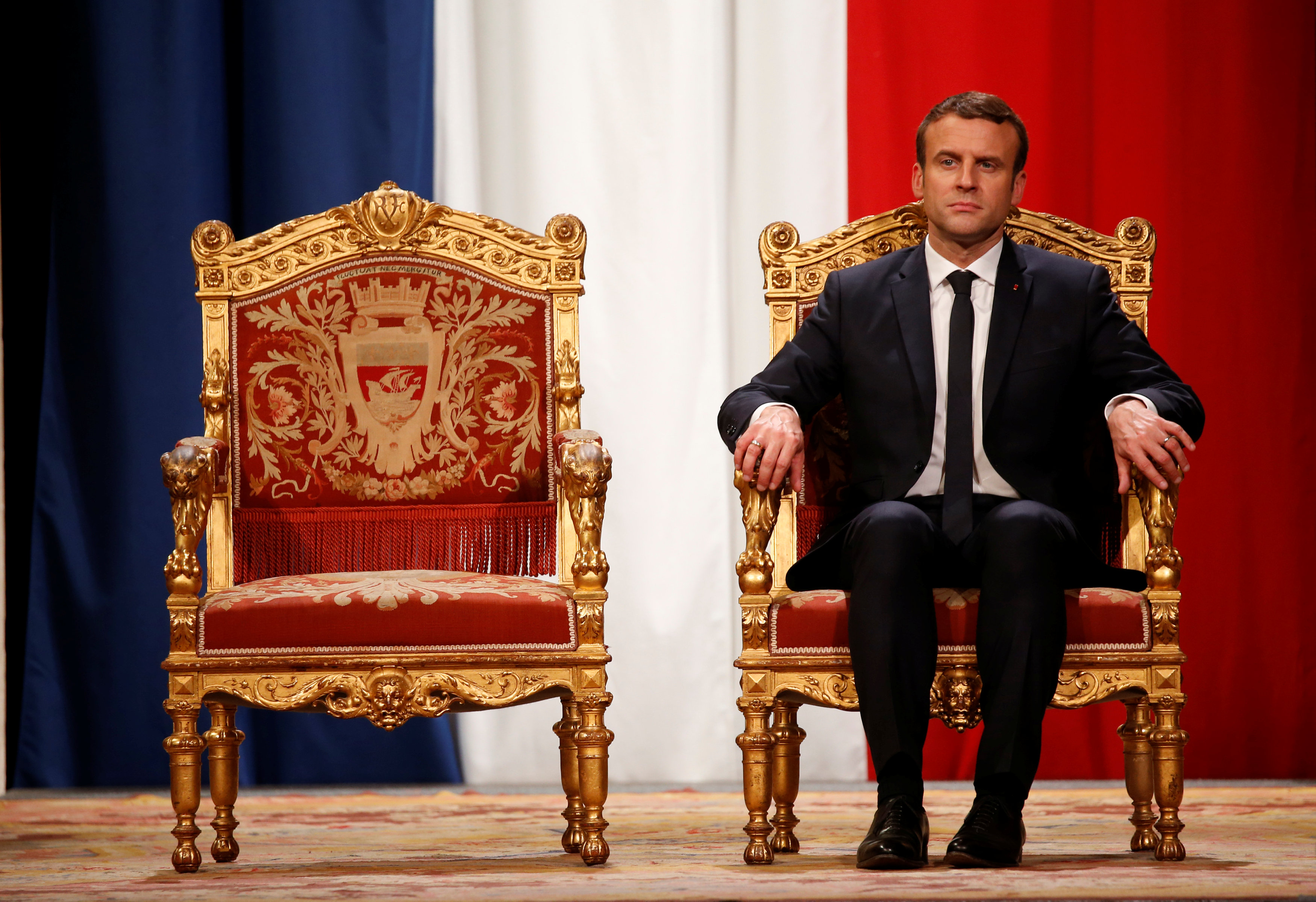 French President Emmanuel Macron listens as Paris Mayor Anne Hidalgo delivers her speech during a ceremony at the Hotel de Ville in Paris, France on May 14, 2017. (REUTERS/Charles Platiau)