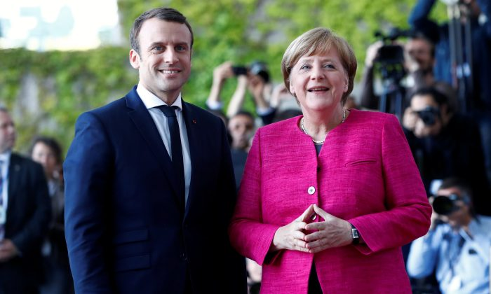 German Chancellor Angela Merkel and French President Emmanuel Macron arrive at a ceremony at the Chancellery in Berlin, Germany on May 15, 2017.    (REUTERS/Fabrizio Bensch)