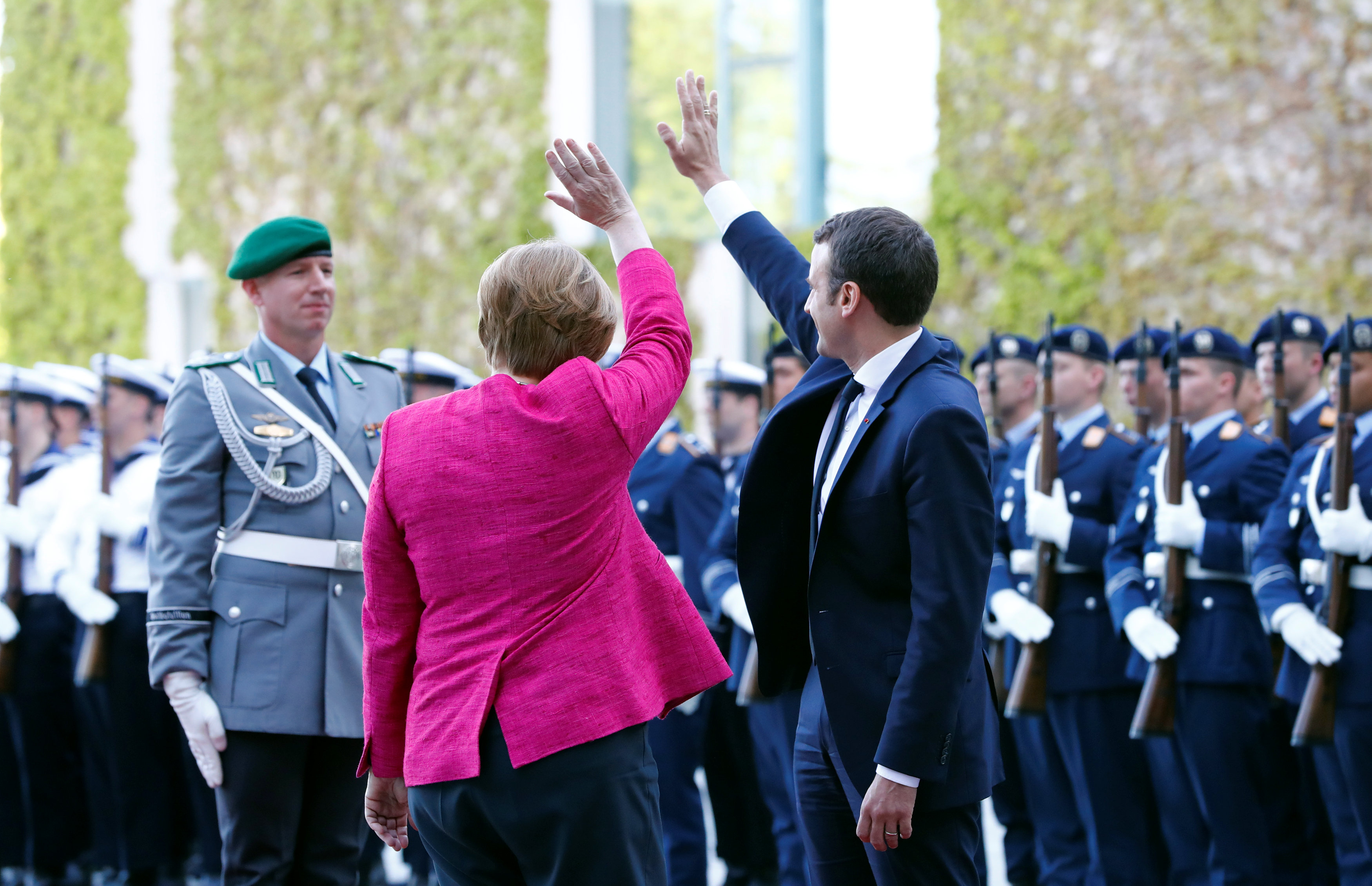 German Chancellor Angela Merkel and French President Emmanuel Macron greet  at a ceremony at the Chancellery in Berlin, Germany on May 15, 2017.    (REUTERS/Fabrizio Bensch)