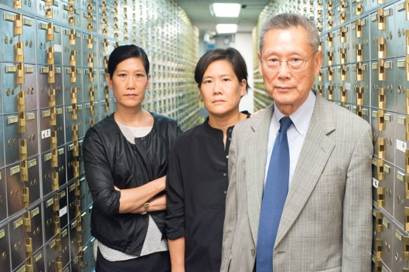 Thomas Sung and two of his daughters as they appear in the documentary,
