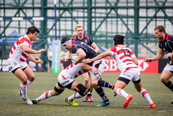 Hong Kong flanker Matt Lamming is covered by the Japanese defense. (Dan Marchant)