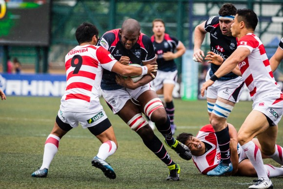 Hong Kong Lock Adrian Griffiths powers into the Japanese scrumhalf and captain Yukata Nagare. (Dan Marchant)
