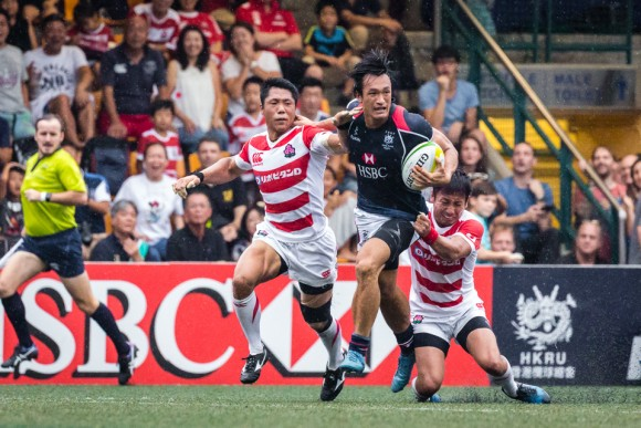Hong Kong winger Salom Yiu Kam shing looks to break the Japan defense. (Dan Marchant)