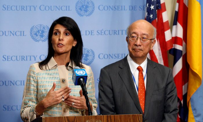 U.S. Ambassador to the United Nations Nikki Haley speaks while Japan's U.N. Ambassador Koro Bessho (L) looks on during a press encounter ahead of an emergency meeting of the U.N. Security Council at the United Nations in New York on May 16, 2017. (REUTERS/Brendan McDermid)