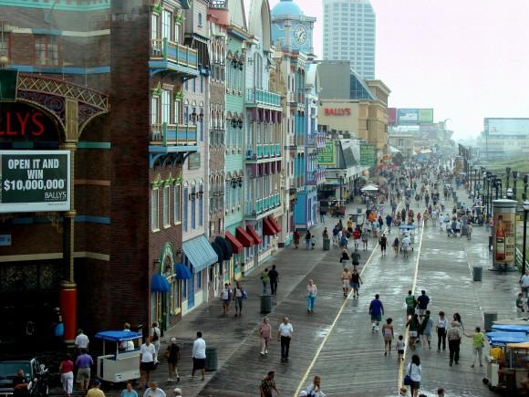 People stroll along Atlantic City's famous boardwalk. The wood is laid in a herringbone pattern. (Italo2712/English Wikipedia)