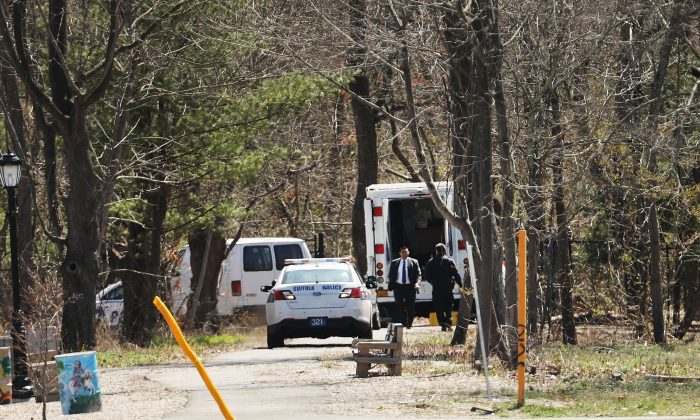 Police investigate the site where four young men were found murdered in a park in Central Islip, Long Island, on April 13, 2017. (Spencer Platt/Getty Images)