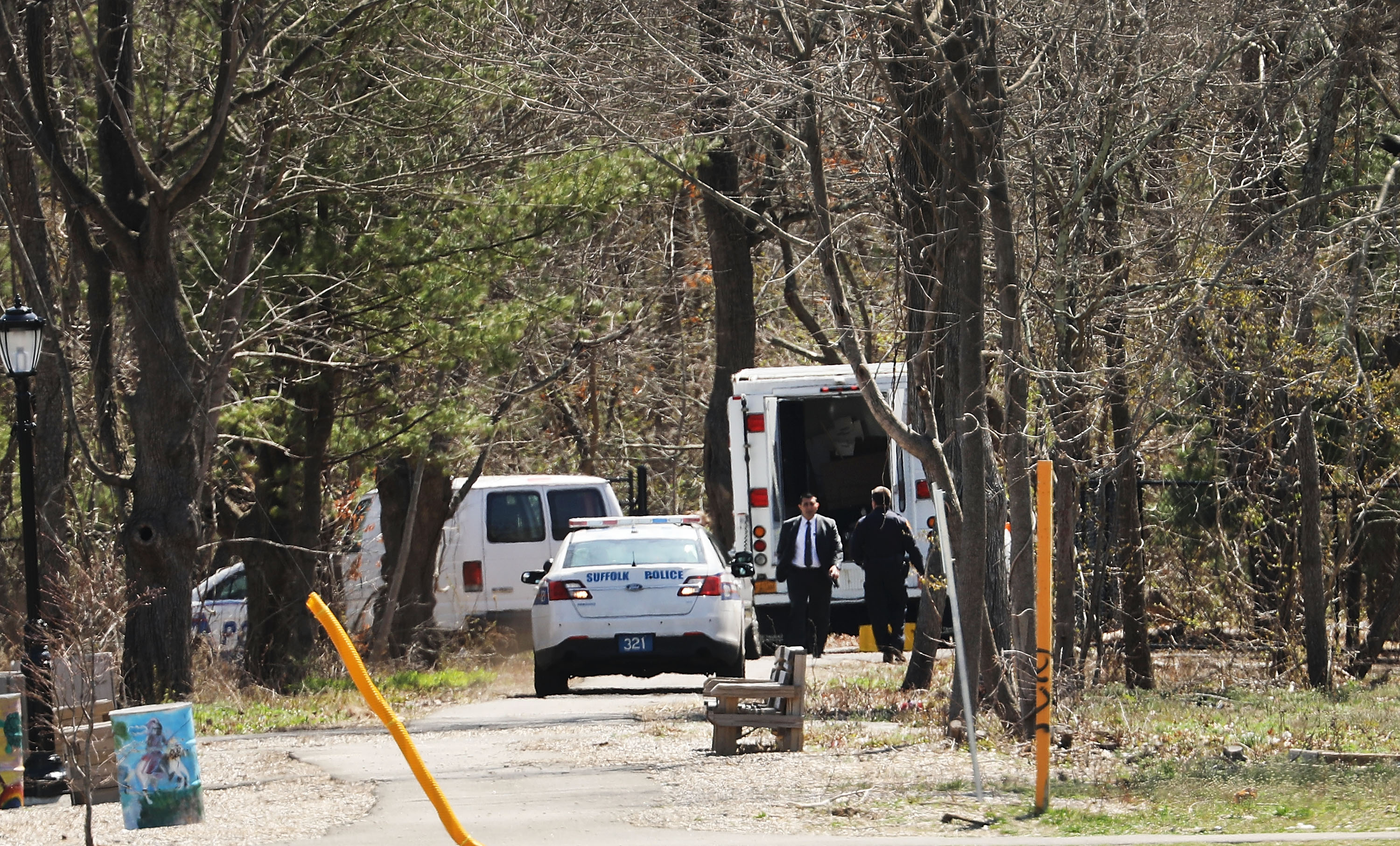 Police investigate the site where four young men were found murdered in a park in Central Islip, Long Island, on April 13. (Spencer Platt/Getty Images)