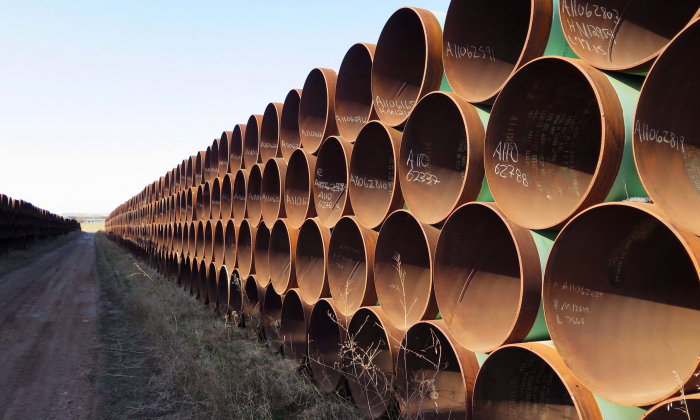 Pipes destined for the Keystone XL pipeline are stacked in Gascoyne, North Dakota, April 22, 2015. (The Canadian Press/Alex Panetta)