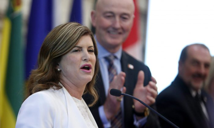Interim Conservative Party leader Rona Ambrose receives a standing ovation as she addresses the Conservative National Caucus for the final time as Leader of the Official Opposition, in Ottawa on May 17, 2017. (The Canadian Press/Fred Chartrand)