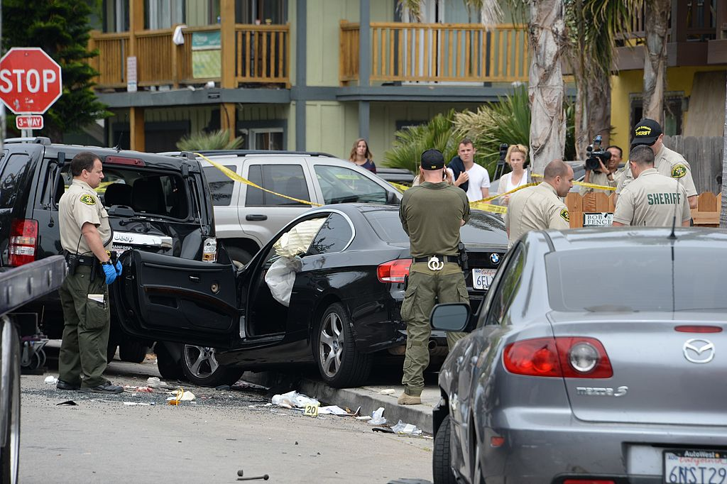 Investigators inspect a suspected gunman's car on May 24, 2014, after a drive-by shooting in Isla Vista, California, a beach community next to the University of California Santa Barbara. (ROBYN BECK/AFP/Getty Images)