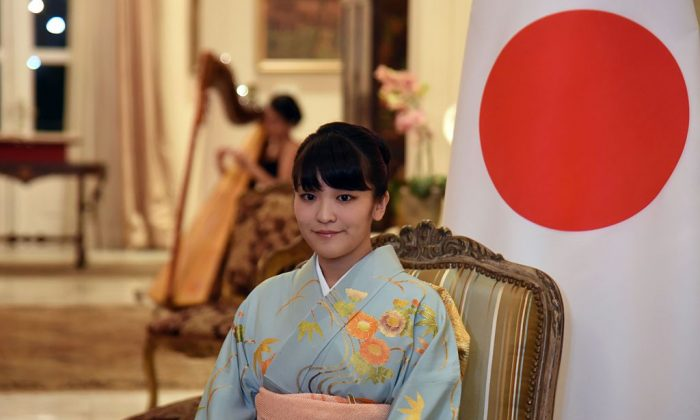 Japan's Princess Mako during a meeting with Paraguayan President Horacio Cartes at the government house Mburuvicha Roga in Asuncion on Sept. 8, 2016. (NORBERTO DUARTE/AFP/Getty Images)