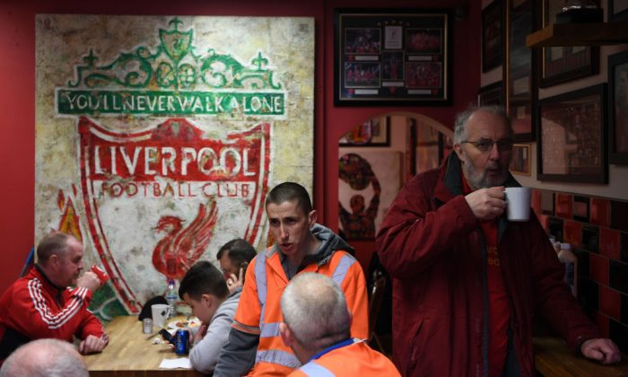 Liverpool fans enjoy some pre-match food in a local cafe prior to the Premier League match between Liverpool and Everton at Anfield in Liverpool, England on April 1, 2017.  (Gareth Copley/Getty Images)