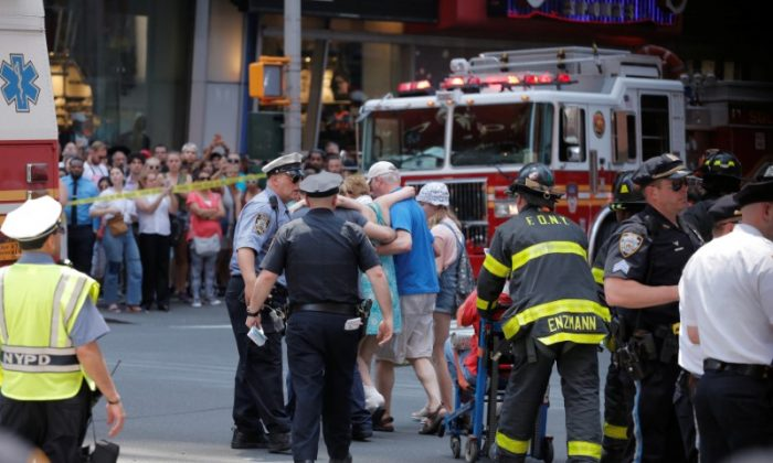 First responders tend to injured pedestrians after a vehicle struck pedestrians on a sidewalk in Times Square in New York, U.S., May 18, 2017.  (REUTERS/Lucas Jackson)