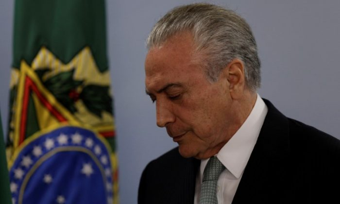 Brazil's President Michel Temer reacts as he speaks at the Planalto Palace in Brasilia, Brazil on May 18, 2017. (REUTERS/Ueslei Marcelino)