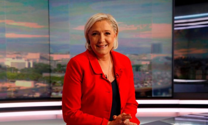 Former French presidential election candidate for the Front National (FN) party Marine Le Pen poses prior to an interview on the evening news broadcast of French TV channel TF1, in Boulogne-Billancourt, near Paris, ahead of the upcoming French legislative election on May 18, 2017. (FRANCOIS GUILLOT/AFP/Getty Images)