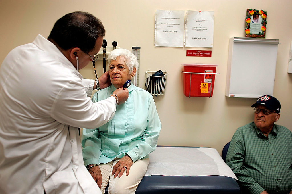 Dr. Ausberto Bianchi checks Ofelia Perez during an exam at the CAC-Florida medical center in Miami, Fla., on March 22, 2007. (Joe Raedle/Getty Images)
