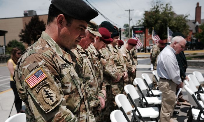 """MORGANTOWN, WV - MAY 18:  Area residents and members of the military participate in the """"Tribute To Heroes"""" ceremony which celebrates the sacrifices area veterans have made for the country on May 18, 2017 in Morgantown, West Virginia. West Virginia, a state where President Donald Trump won in a landslide by defeating Hillary Clinton 67.9 percent to 26.2 percent, is also one of the nations poorest states where nearly one in five West Virginians struggled to afford basic necessities in 2015. The state was historically dependent on coal mining and manufacturing. With coal mines closing, the state has witnessed a surge in male unemployment and an epidemic of opioid use among its population.  (Photo by Spencer Platt/Getty Images)"""