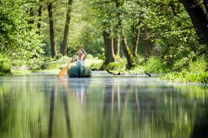 A young woman paddles a canoe on a creek in Loecknitz, Germany, on May 19, 2017. (Thomas Lohnes/Getty Images)