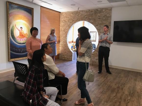 Patrons exploring the 20 paintings in the Art of Zhen Shan Ren Museum, in Tempe, Arizona. (Mel Etherton)