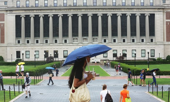 People walk on the Columbia University campus on July 1, 2013 in New York City. (Mario Tama/Getty Images)