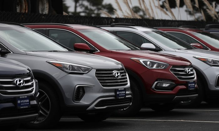 Brand new Hyundai Santa Fe SUVs are displayed at a Hyundai dealership on April 7, 2017 in Colma, California. South Korean automakers Kia and Hyundai announced that they are recalling 1.4 million cars and SUVs in the U.S., Canada and South Korea for a potential problem that causes engine failure or stalling. The recall includes 2013 and 2014 Hyundai Santa Fe Sport SUVs as well as 2011 - 2014 Kia Optima, 2011 - 2013 Kia Sportage SUVs and 2012 - 2014 and Kia Sorento SUVs. (Justin Sullivan/Getty Images)