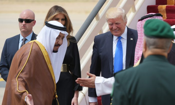 Saudi Arabia's King Salman bin Abdulaziz al-Saud (L) shows the way to US President Donald Trump (C-R) and First Lady Melania Trump upon arrival at King Khalid International Airport in Riyadh on May 20, 2017. (Mandel Ngan/AFP/Getty Images)
