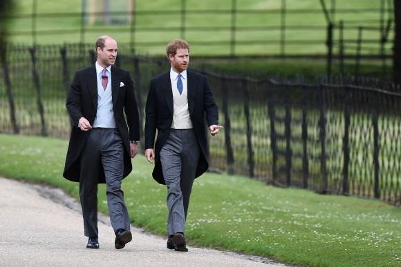 Britain's Prince Harry (R) and Britain's Prince William, Duke of Cambridge walk to the church for the wedding of Pippa Middleton and James Matthews at St Mark's Church in Englefield, west of London, on May 20, 2017. (Justin Tallis/AFP/Getty Images)