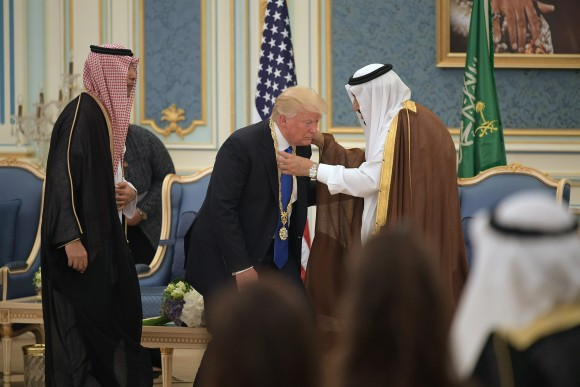 US President Donald Trump (C) receives the Order of Abdulaziz al-Saud medal from Saudi Arabia's King Salman bin Abdulaziz al-Saud (R) at the Saudi Royal Court in Riyadh on May 20, 2017. (Mandel Ngan/AFP/Getty Images)