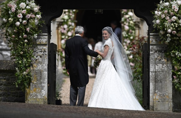 Pippa Middleton (R) is escorted by her father Michael Middleton as she arrives for her wedding to James Matthews at St Mark's Church on May 20, 2017 in Englefield Green, England. (Justin Tallis - WPA Pool/Getty Images)
