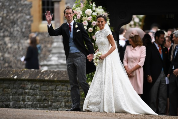 Pippa Middleton and her new husband James Matthews leave St Mark's Church in Englefield, west of London, on May 20, 2017 following their wedding ceremony. After turning heads at her sister Kate's wedding to Prince William, Pippa Middleton graduated from bridesmaid to bride on Saturday at a star-studded wedding in an English country church. Middleton, married financier James Matthews, 41, at a ceremony attended by the royal couple and tennis star Roger Federer, as she wore a couture dress by British designer Giles Deacon. (Justin Tallis/AFP/Getty Images)