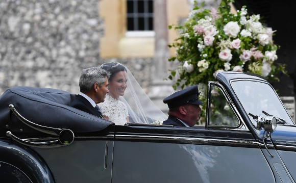 ENGLEFIELD GREEN, ENGLAND - MAY 20: Pippa Middleton arrives with her father Michael Middleton in a 1951 Jaguar Mk V car, for her wedding ceremony at St Mark's Church as the bridesmaids and pageboys walk ahead on May 20, 2017 in Englefield Green, England.  (Photo by Justin Tallis - WPA Pool/Getty Images)