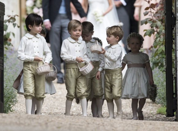 ENGLEFIELD GREEN, ENGLAND - MAY 20: Prince George, fourth left, stands with other flower boys and girls after the wedding of Pippa Middleton and James Matthews at St Mark's Church onMay 20, 2017 in Englefield, England. (Photo by Arthur Edwards - WPA Pool/Getty Images)