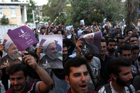 Supporters of newly re-elected Iranian President Hassan Rouhani take to the streets to celebrate his victory in downtown Tehran on May 20, 2017. (Behrouz Mehri/AFP/Getty Images)