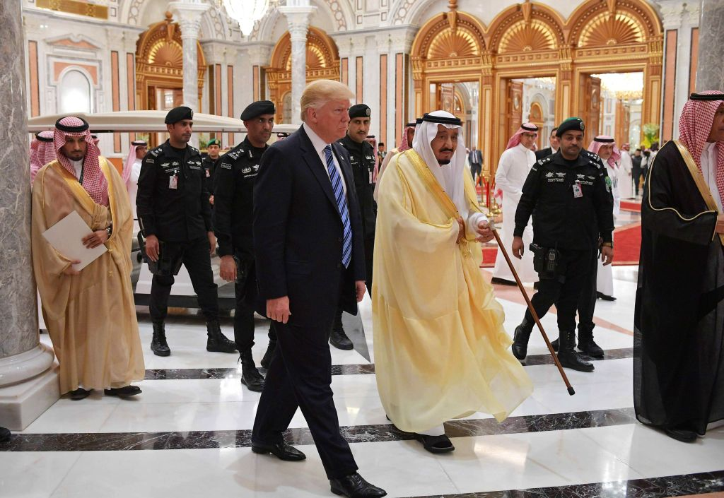 President Donald Trump (C-L) and Saudi Arabia's King Salman bin Abdulaziz al-Saud (C-R) arrive for the Arabic Islamic American Summit at the King Abdulaziz Conference Center in Riyadh on May 21, 2017. (MANDEL NGAN/AFP/Getty Images)