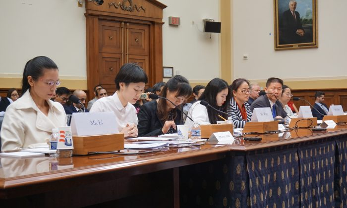 A panel consisting of four wives speaking on behalf of their husbands, detained in China for advocating for human rights, on May 18, in a hearing room on Capitol Hill. (L-R) Ms. Lee Chin-yu, wife of Lee Min-che; translator; Ms. Wang Yanfeng, wife of Tang Jingling; translator; Ms. Jin Bianling, wife of Jiang Tianyong; Bob Fu, president of China Aid; Ms. Chen Guiqiu, wife of Xie Yang. (Kitty Wang/NTD)