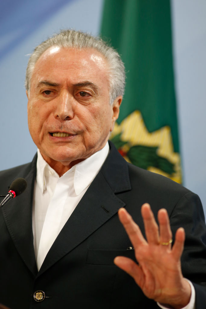 Brazilian President Michel Temer delivers a new statement following the release of a tape allegedly demonstrating him condoning bribery payments to Chamber of Deputies President Eduardo Cunha in Brasilia, Brazil on May 20, 2017. (Getty Image)