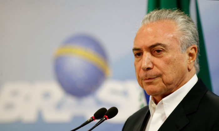 President Michel Temer delivers a new statement following the release of a tape allegedly demonstrating him condoning bribery payments to Chamber of Deputies President Eduardo Cunha in Brasilia, Brazil on May 20, 2017. (Getty Image)