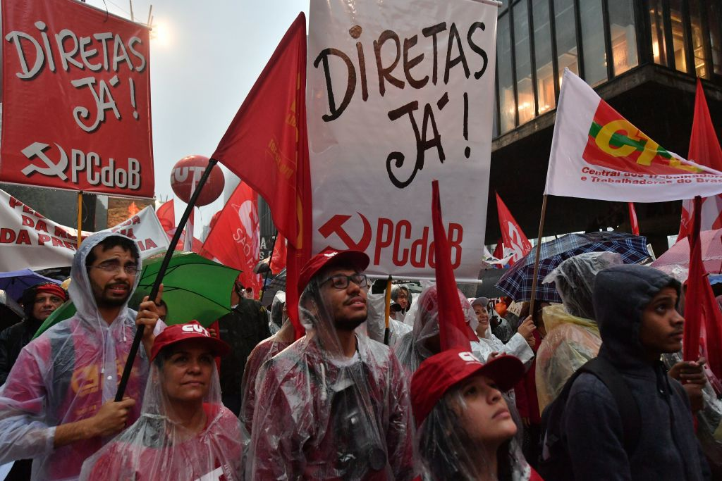Demonstrators protest against Brazilian President Michel Temer along Paulista Avenue in Sao Paulo Brazil on May 21 2017.  (NELSON ALMEIDA/AFP/Getty Images)