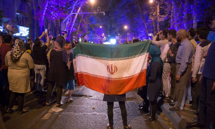 Supporters of Iranian President Hassan Rouhani celebrate after he won the presidential election  in Tehran, Iran on May 20, 2017.  (Majid Saeedi/Getty Images)