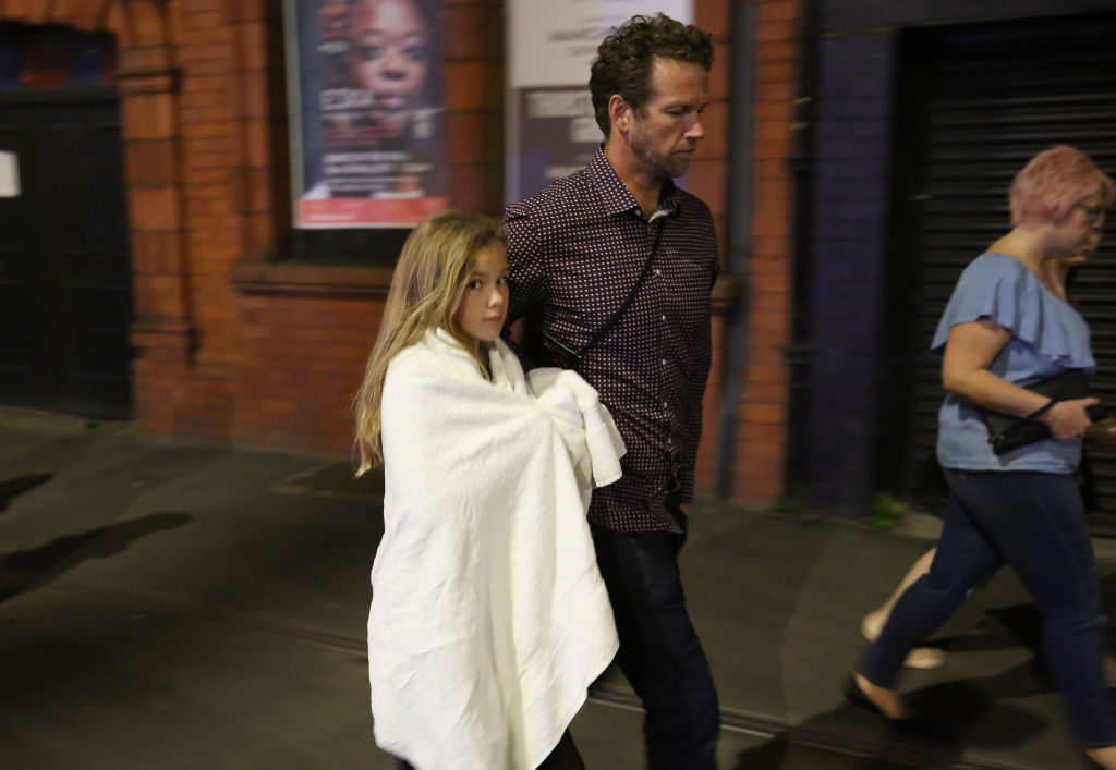 Police escort members of the public from the Manchester Arena in Manchester, England on May 23, 2017. (Christopher Furlong/Getty Images)
