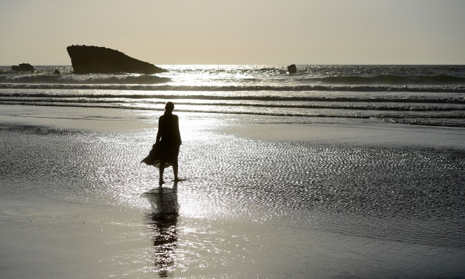 A woman walks on the beach in Biarritz, southwestern France, on May 23, 2017. (FRANCK FIFE/AFP/Getty Images)